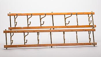 "KLÄDHÄNGARE, 2 st, ""Dekorativ"", Skoglunds Metallgjuteri, 1900-talets andra hälft."