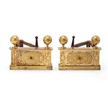 1302. EMPIRE, A pair of French Empire early 19th century gilt bronze chenets.