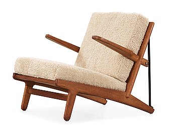 21. BØRGE MOGENSEN, an oak and iron easy chair, Fredericia, Denmark 1950's.