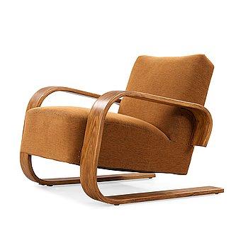 11. Alvar Aalto, a 'model 400' easy chair, The Tank, made on license by Aalto Design Hedemora Sweden 1946-56, for Artek.