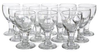 11. A SET OF 12 BEER GLASSES,