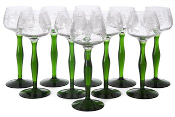 9. A SET OF TEN WHITE WINE GLASSES.
