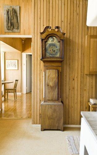 A long case clock,