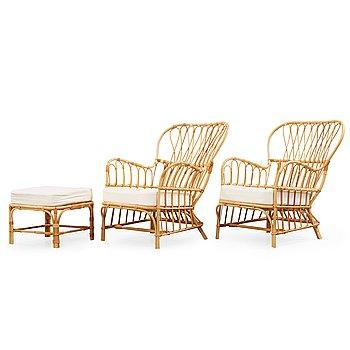 359. Josef Frank, a pair of rattan easy chairs and a stool, Svenskt Tenn Sweden.