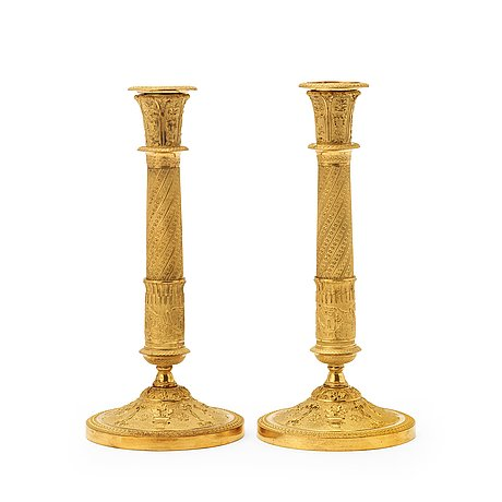 A pair of french empire early 19th century candlesticks.
