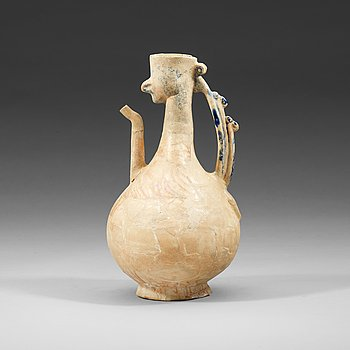 800. EWER. Pottery. Probably Kashan 12th-13th century, Iran. Height 27 cm.