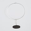 Vivianna torun bülow-hübe, a silver necklace with a beach stone pendant, executed in her own workshop, stockholm 1961.