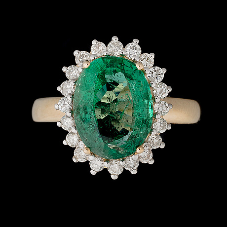 A ring, facetted emerald, brilliant cut diamonds, 18k gold