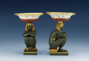 A pair of 'Egyptian' tazzas, Empire. (2). Height 27 cm, diameter of tazza 19,5 cm.