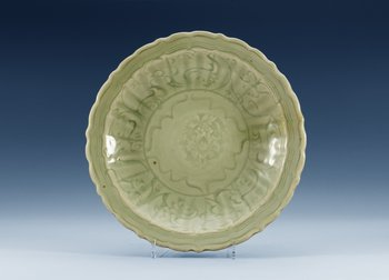 A Longquan celadon barbed-rim dish, Ming dynasty. (1368-1644).