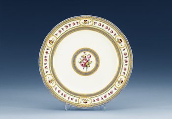 A Sèvres lobed plate, 18th century, with painter´s mark Madame Taillandier. Gilders mark for E-G Girard. Diameter 24,5 cm.