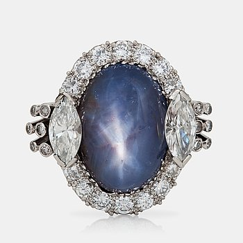 571. A cabochon-cut star sapphire and diamond ring.