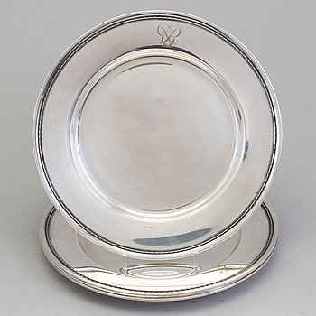 Four monogrammed Swedish silver charger plates, Makers's mark GAB, Stockholm, 1949.