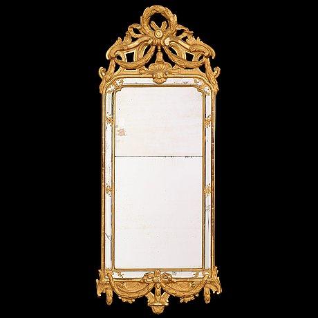 A gustavian mirror by n meunier dated 1774.