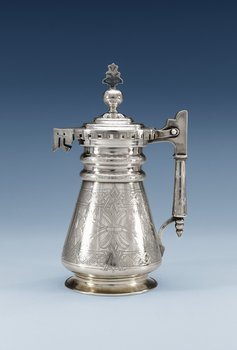 1144. A RUSSIAN PARCEL-GILT JUG, makers mark of S.M. Ikonnikov, Moscow 1877.