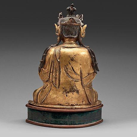 A gilt bronze figure of guanyin, ming dynasty (1368-1644).