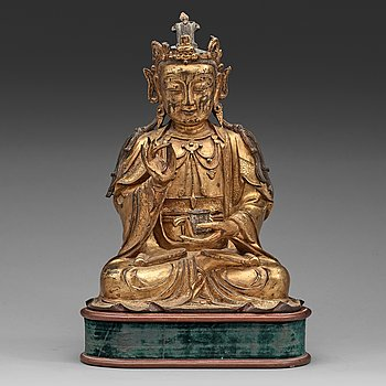 2. A gilt bronze figure of Guanyin, Ming dynasty (1368-1644).