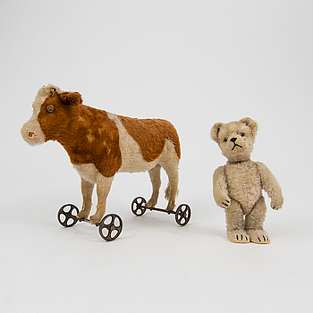 "A Steiff cow and a Schuco ""Tricky"", Germany, 1910 and 1930/40s."