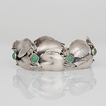 ARMBAND, silver samt cabocholslipade malakit, Gertrud Engel för A Michelsen, Stockholm 1950. Vikt ca 34 gram.