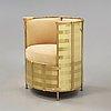 Mats theselius, an 'el dorado' leather and brass armchair, källemo, sweden post 2002.