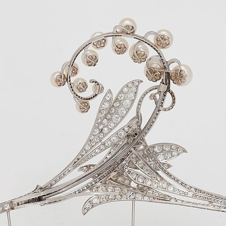 A tiara/brooch set with old cut diamonds and possibly cultured pearls, with noble provenance.