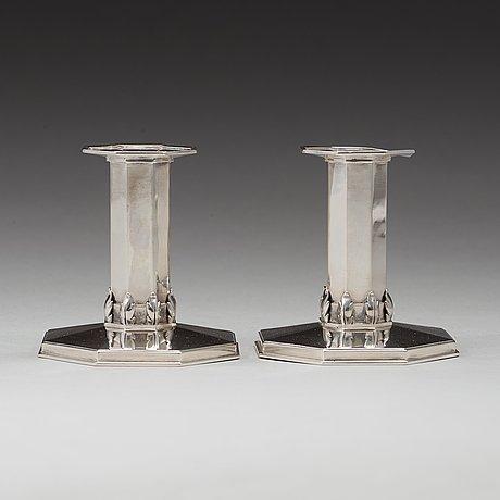 A pair of atelier borgila sterling candlesticks, stockholm 1933.