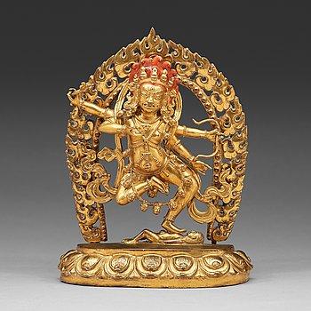 12. A gilt bronze figure of Kurukulla, presumably circa 1900.