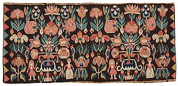 """415. A CARRIAGE CUSHION. Tapestry weave. """"Urnor och par"""". 48,5 x 101,5 cm. Southern Scania, Sweden, 19th century."""