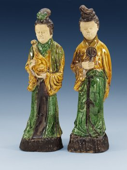 Two figures of court attendants, Ming dynasty (1368-1644). (2). Height 34 cm.