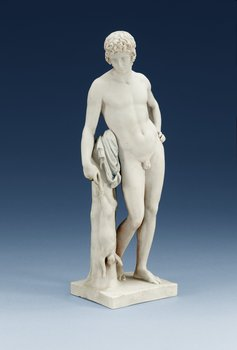 A Royal Copenhagen bisquit figure of a young man, 19th Century. Height 32 cm.