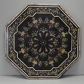 An oktagonal stone table top with inlays, Italy, about 1900.