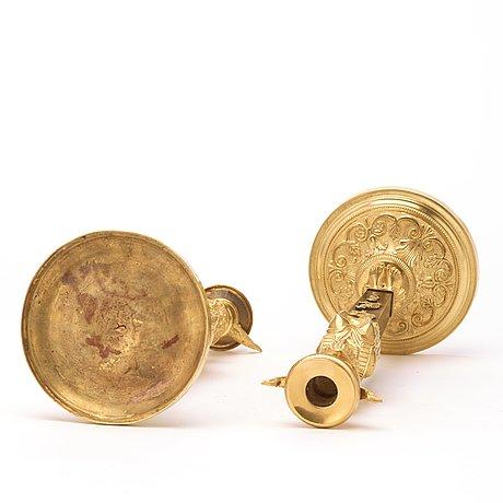 A pair of empire circa 1810 candlesticks.