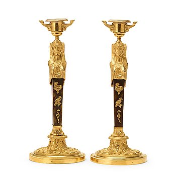 597. A pair of Empire circa 1810 candlesticks.