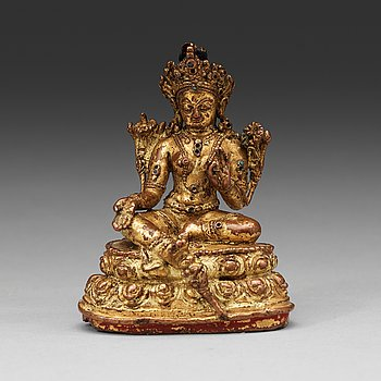4. A Tibetan gilt copper alloy figure of Syamatara, 16th Century or earlier.