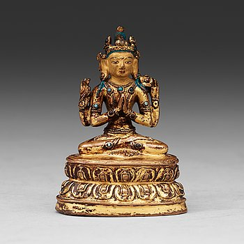5. A gilt copper alloy four armed Tibetan figure of Shadakshari Lokeshvara, 16th Century or earlier.