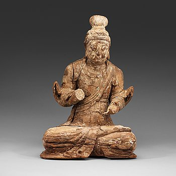 16. A wooden sculpture of a seated Bodhisattva, presumably Ming dynasty (1368-1644).