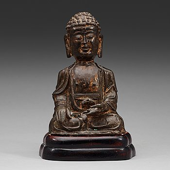 10. A bronze figure of Buddha, Ming dynasty (1368-1644).