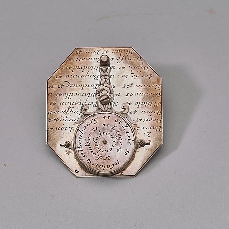 An early 18th century langlois a paris silver sundial and compass.
