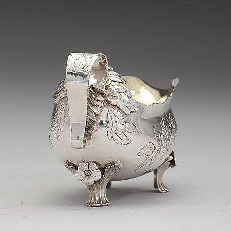 A swedish 18th century parcel-gilt cream-jug, mark of lars boye, stockholm 1776.