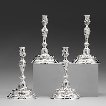 101. Two pairs of Swedish 19th and 20th century silver candlesticks, mark of Mollenborg and Jensen, Stockholm 1857 and 1936.