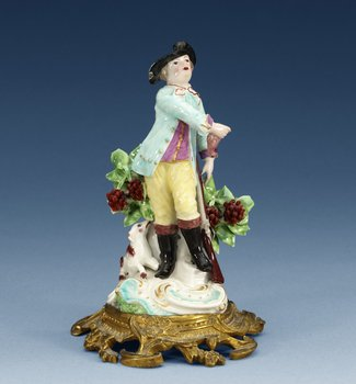 A gilt bronze mounted 18th Century porcelain figure of a huntsman, presumably English. Height 18 cm.