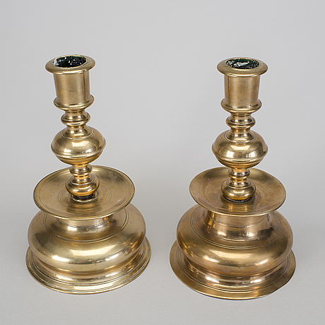 A set of two 18th century baroque brass candle sticks.