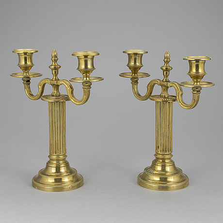 A pair of french 18th century brass candelabras.