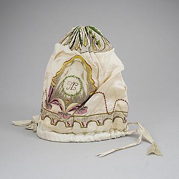 A night cap in silk dated 1801.