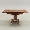A mahogany table in karl johan style early 20th century