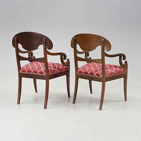 A pair of karl johan mahogany armchairs first half of the 19th century.