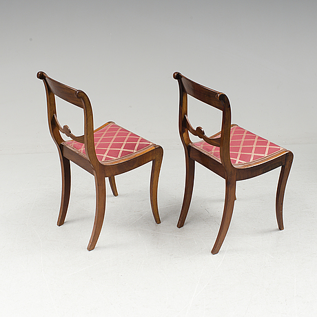 A pair of karl johan mahogany chairs first half of the 19th century.