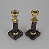 A pair of late gustavian porphyry candle sticks early 19th century.