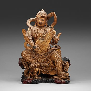 8. A wooden sculpture of a guardsman, Ming dynasty, (1368-1644).