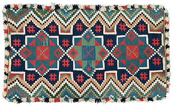 418. A CARRIAGE CUSHION. Double-interlocked tapestry. 49 x 85,5 cm. Scania, Sweden, 19th century.